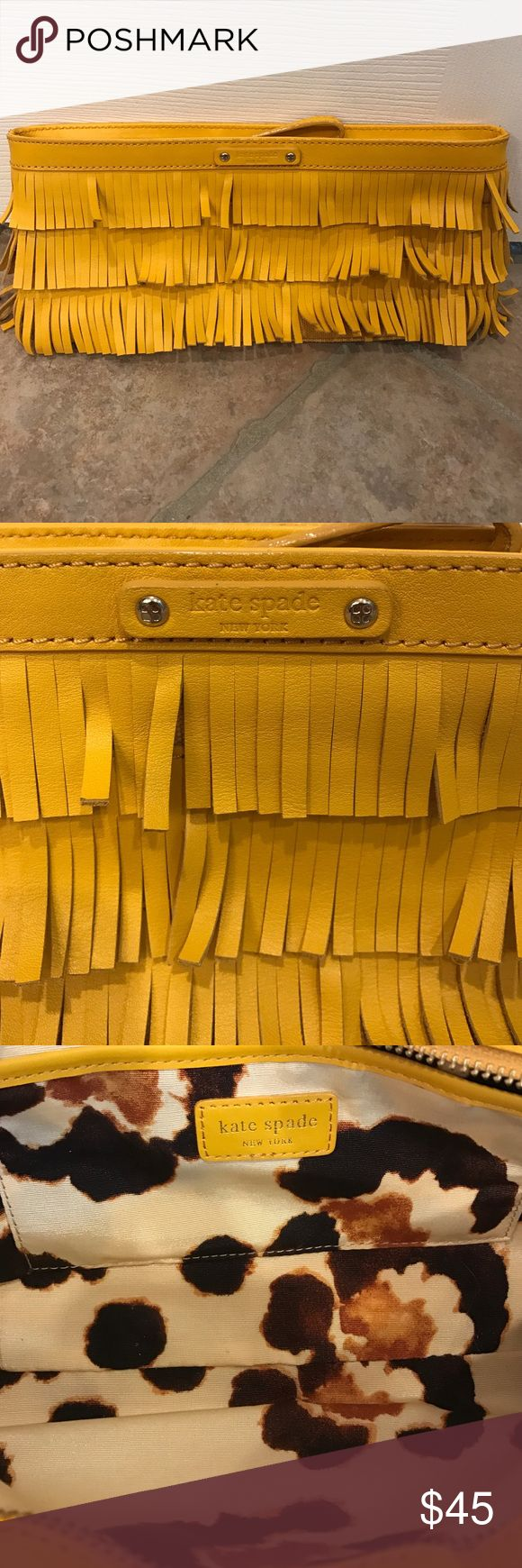 Kate Spade Mustard Fringe Clutch Excellent condition. Mustard leather fringe clutch with a wrist strap that can be used or tucked away. The inside is a fun leopardy print.   Measurements are as follows: 12x5.5x1.5 kate spade Bags Clutches & Wristlets