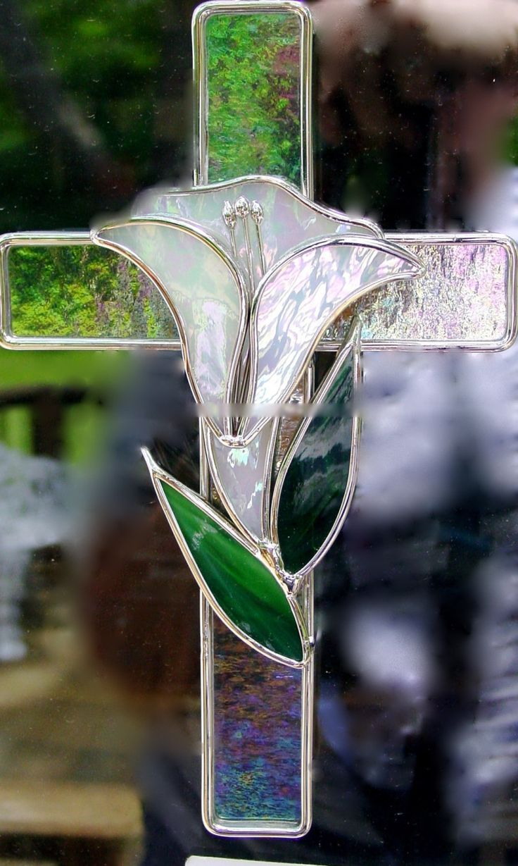 Cross with the lily representing Christ's resurrection from the dead.