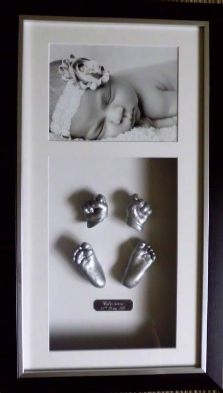 Beautiful 3D baby hands feet in silver with a black and white photo , and black frame. Love it ! www.keepskae4u.com.au