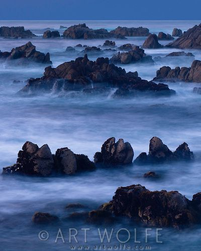 A four minute time exposure of ocean surf and coast rocks.
