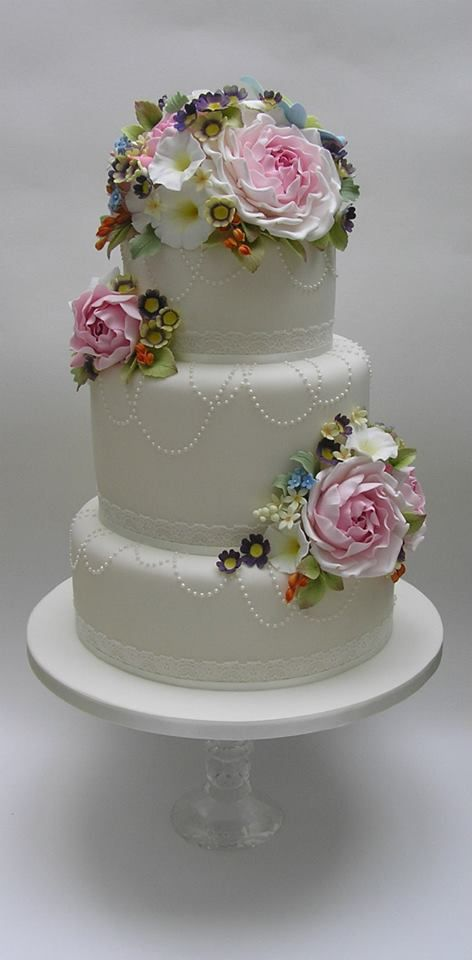 Traditional white wedding cake with white on white pearl detail and floral topper | Scrum Diddly    ᘡղbᘠ