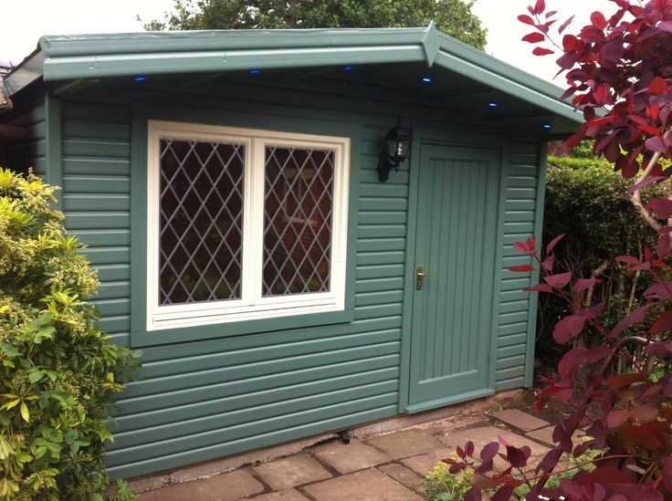 Small garden log cabin | Painted green with white trims