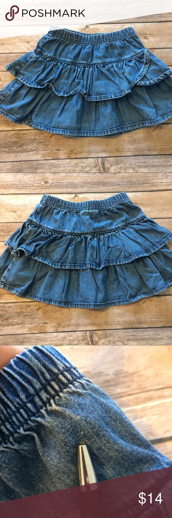 Hanna Andersson tiered ruffle denim skirt size 100 Great basic wardrobe staple. Guc because not first owners and small pin hole on front (see photo). Elastic waist and tiered ruffles. Size 100 which is approx size 4 or fit for age 3 to 5 years. 100% cotton. Smoke free dog friendly home. Always a bundle discount in my closet. Hanna Andersson Bottoms Skirts