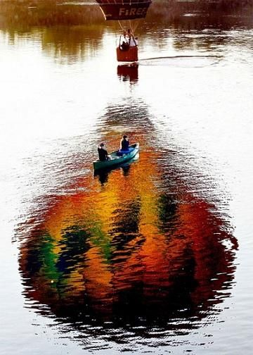 balloon over boat on a lake