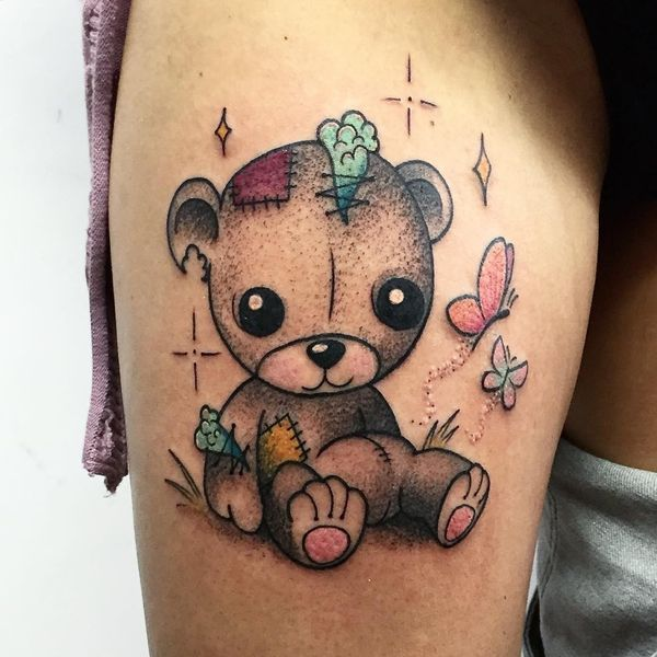 45 Extraordinary Teddy Bear Tattoos -    	The lovely teddy bear tattoo performed in the traditional brown color adorns the thigh. If you are a huge fan of teddy bears, you can immortalize you love to this soft toy in this …