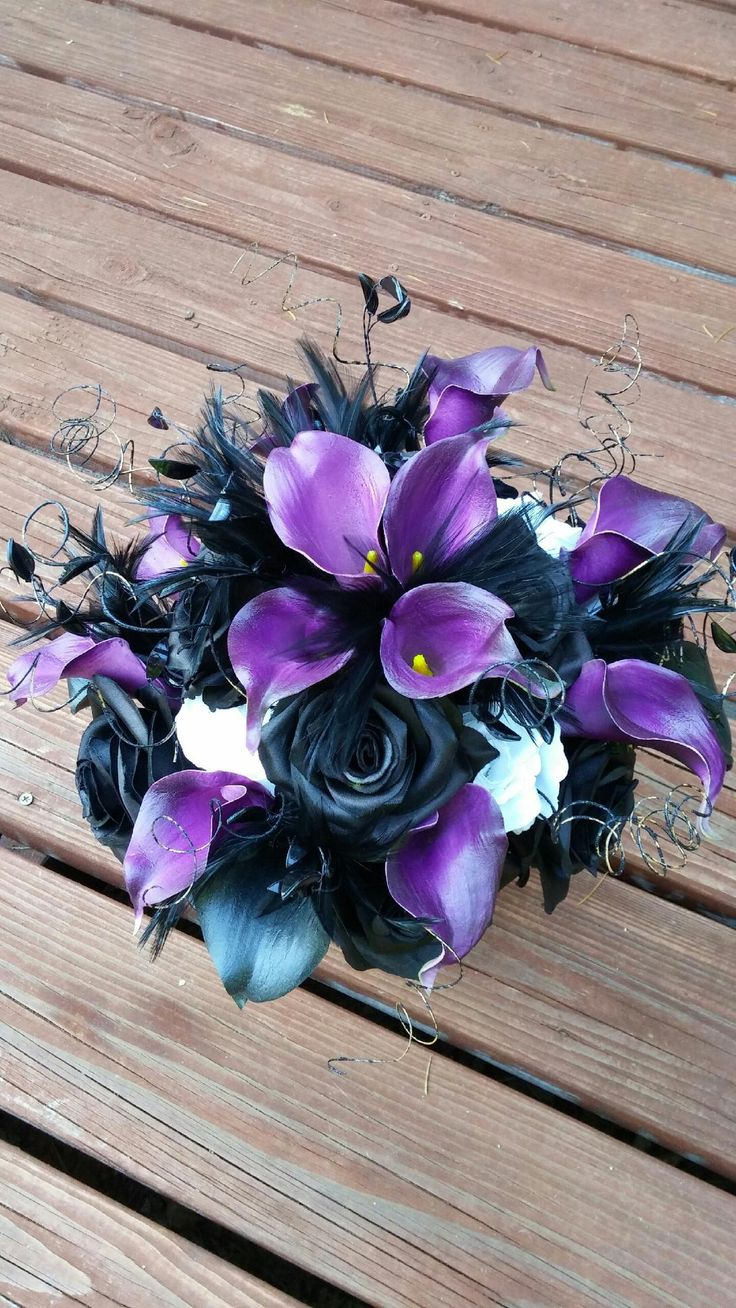 Black and purple bouquet, Calla lilly, roses, feathers. Stunning bouquet for my black and purple nightmare before Christmas wedding. In love with this arrangement