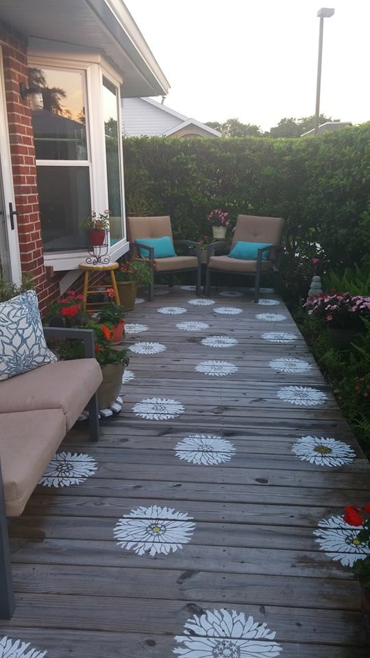 A deck stenciled with the Starburst Zinnia flower stencil from Cutting Edge Stencils. http://www.cuttingedgestencils.com/flower-stencils-starburst-zinnia-wall-art-stencil-floral.html