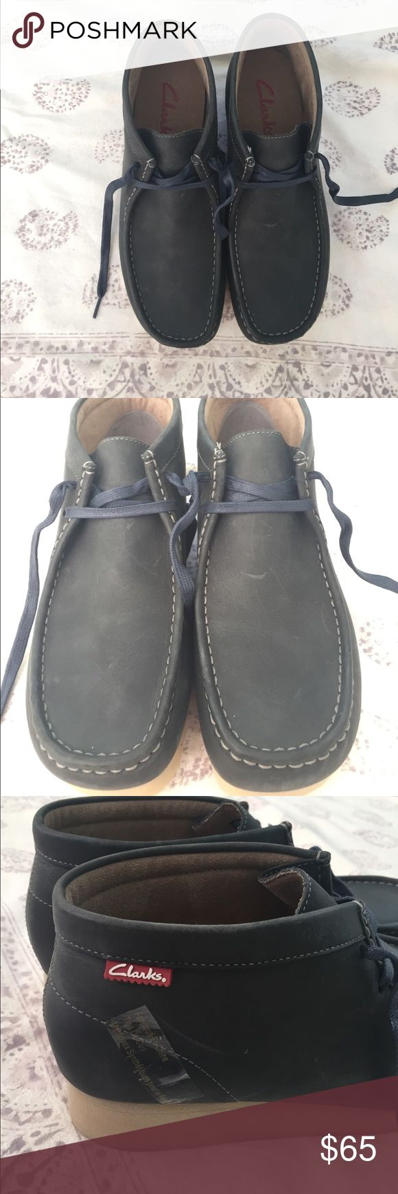 Navy Clarks Wallabees Never worn!!! NWOT! Clark's classic wallabees. Unique navy color, navy laces and beige sole. Men's 9, could fit women's 11! Dress them up or down, super versatile ! Clarks Shoes