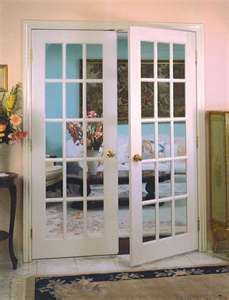 My childhood home had beautiful french doors dividing the living room from the formal dining room. I love them...