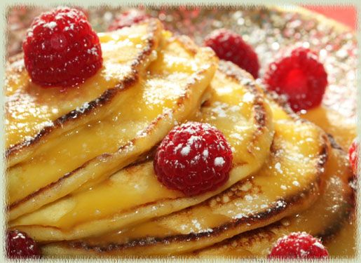 Bobby Flay's recipe for lemon ricotta pancakes with lemon curd and fresh raspberries