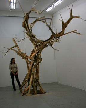 Huge tree sculpture made from wood pallets. The circle is complete.