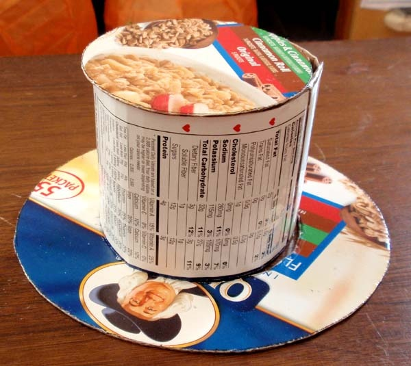 diy top hat - could use a large round carton (ice cream carton, hat box, round bucket, etc) add a cardboard brim and cover in purple felt