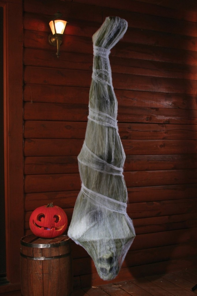 spook your party guests with this cocoon corpse hanging decoration this is a scary spiderweb halloween decoration - Scary Halloween Decoration