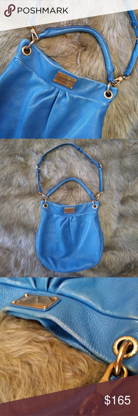 """Marc by Marc Jacobs Classic Q Hillier Hobo Bag Marc by Marc Jacobs Classic Q Hillier Hobo Bag in Blue. Shoulder and hand strap. 2 inner side pouches. Inside zip compartment. Magnet closure. Color fading in areas (pictured) but othetwise excellent condition. Approx 14"""" Wide x 13"""" Height x 31"""" Long Shoulder Strap. Marc By Marc Jacobs Bags"""