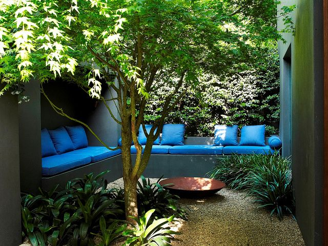 enclosed residential garden with a firepit