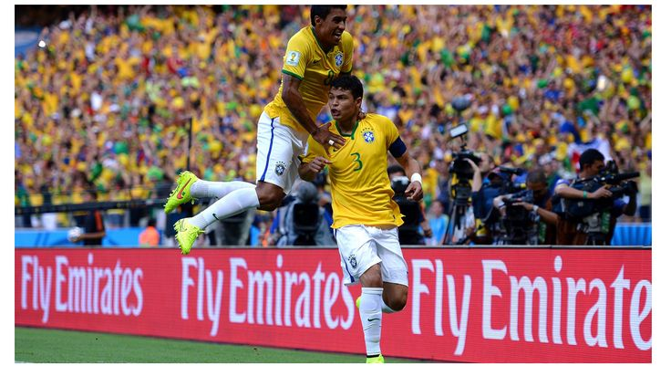 Thiago Silva of Brazil celebrates scoring Friday, 4 July 2014 FORTALEZA, BRAZIL - JULY 04: Thiago Silva (R) of Brazil celebrates scoring his team's first goal with his teammate Paulinho during the 2014 FIFA World Cup Brazil Quarter Final match between Brazil and Colombia at Estadio Castelao on July 4, 2014 in Fortaleza, Brazil.