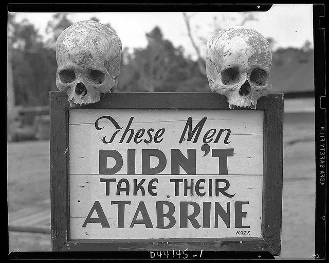These men didn't take their Atabrine, an anti-malaria drug. Sign was posted at the 363rd Station Hospital.