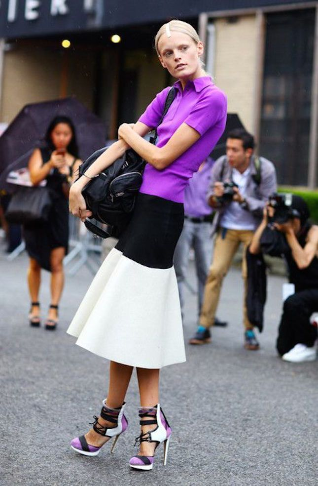 Fashion Week-Ready: For a runway-ready look, don't be afraid to experiment by mixing a polo shirt with fashion-forward pieces like this voluminous skirt and lace-up stilettos.