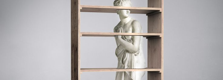 Use this idea with maybe another piece of art?  fabio novembre embeds antonio canova's venus into bookcase for driade