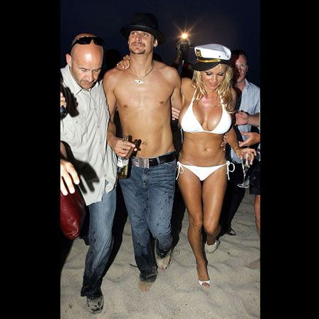 """Unorthodox Bridal Outfits - When a Baywatch babe gets married, what else should she wear but a bikini? Pam Anderson showed off her shapely bride bod at her 1996 wedding to Kid Rock in a white Melissa Odabash bikini.............   Britney Spears cemented her love for Kevin Federline and then immediately slipped out of her dress into a Juicy Couture velour sweatsuit embroidered with the words """"Mrs. Federline."""""""