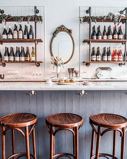 Love the eclectic mix of vintage French and industrial farmhouse-style pieces in Brunette Wine Bar!