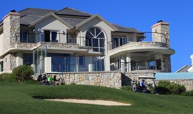 #HomesInWesternCape #PropertyForSale # Mossel Bay   #CPT #GardenRoute #ResidentialEstates  Pure luxury situated on the 12th Fairway with magnificent views across the White waters of Eden bay. This home offers en-suite staff quarters,cinema room and wine cellar which complete the retirement rooms, an elegant lounge ,dining and cocktail bar area, with a designer kitchen, a rim flow large pool with adjoining jacuzzi and a double garage.