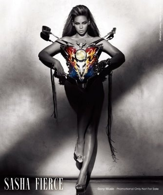 Her outfit is used to symbolize her body as a motorcycle with the Baphomet featured front and center. Sasha Fierce is communicating that her she is a vehicle for Satan.  The Signal of Baphomet represents the Church of Satan.