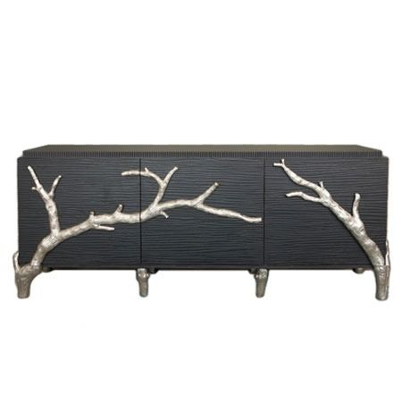 I think you could mimic this for a furniture makeover. Sculpt branches with some kind of modeling clay and paint them? I bet you could even get real branches and cut them in half.... might not actually work. haha