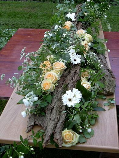 Mourning flowers on a base of bark