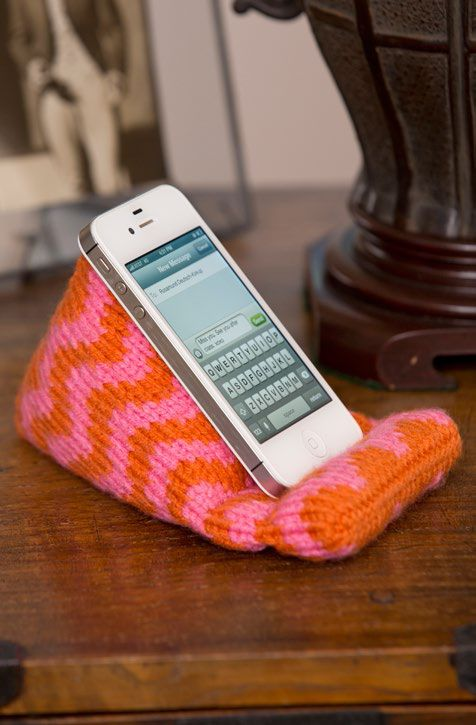 Free Knitting Pattern for Cell Phone Resting Place - I need one! This easy pattern creates stand for your mobile phone so you can keep an eye on it hands free. Great for Face Time, or if you're watching video while you're knitting, or reading a digital pattern. Great gift idea and stash buster! Designed by Sahrit Freud-Weinstein for Red Heart.