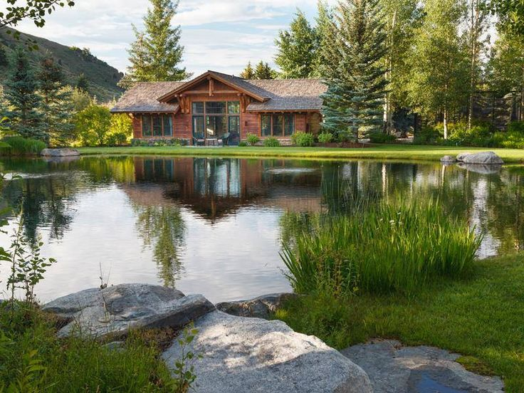 Gorgeous setting for a log home complete with its own man-made lake/pond!