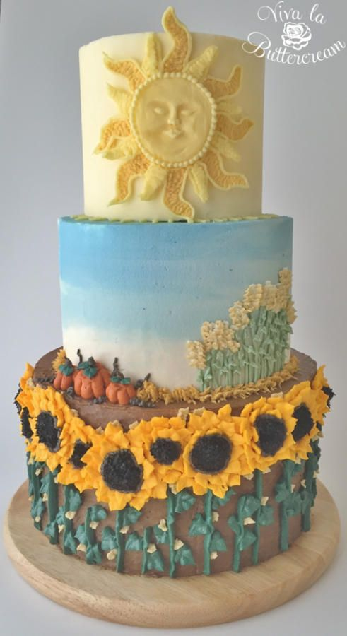 """""""Harvest"""" – 100% Buttercream Mural Cake. Featuring textured Buttercream, ombre watercolour, hand piped Sunflowers, wheat, and pumpkins, and hand sculpted and piped Buttercream Sun. You reap what you sow, so plant a good crop <3"""