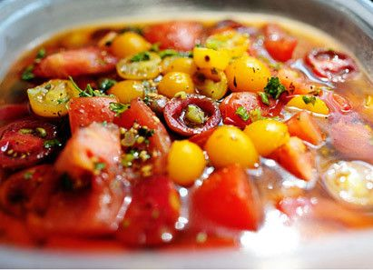 Marinated Tomatoes. It's an easy make-ahead summer barbeque side dish, and just begging for a crusty baguette to sop up all those garlicky, tomatoey olive oil juices.