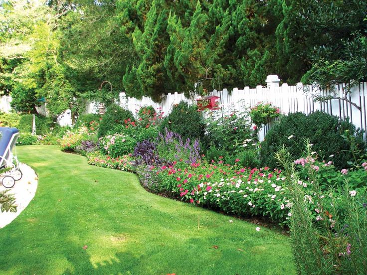 lanscape with knock out roses garden with a white