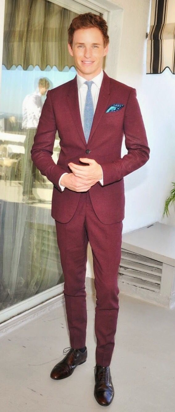 Eddie Redmayne is wearing a Burberry burgundy suit at the BAFTA Los Angeles and Britannia Awards luncheon. Maroon Red Suit