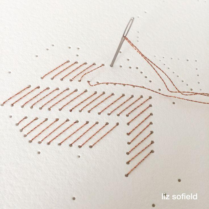 Copper thread, hand stitching words.