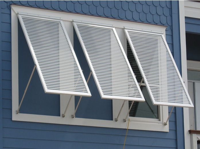 What Are Bahama Shutters Pros Cons Cost And More Bahama Shutters Shutters Exterior Aluminum Shutters