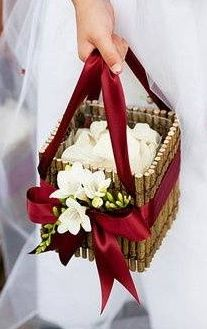 Flower petals in a pretty wooden basket