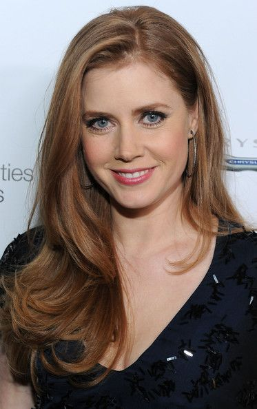Amy Adams. This is about the color of my natural hair. My goal is to grow it all back out... I just chopped it all off and dyed it dark and now I'm regretting it!