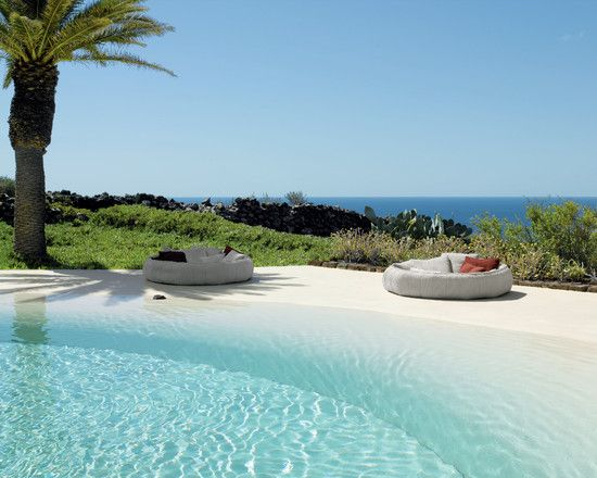 I love this!  A pool that looks like the beach!