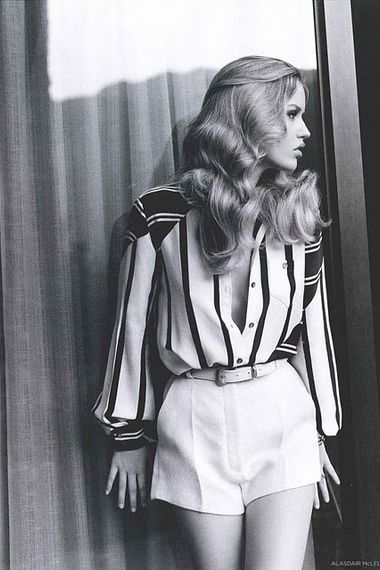 Georgia May Jagger / 70s editorial in a striped button up and high waisted white shorts