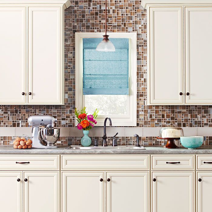 Creamcolor tile backsplash to ceiling