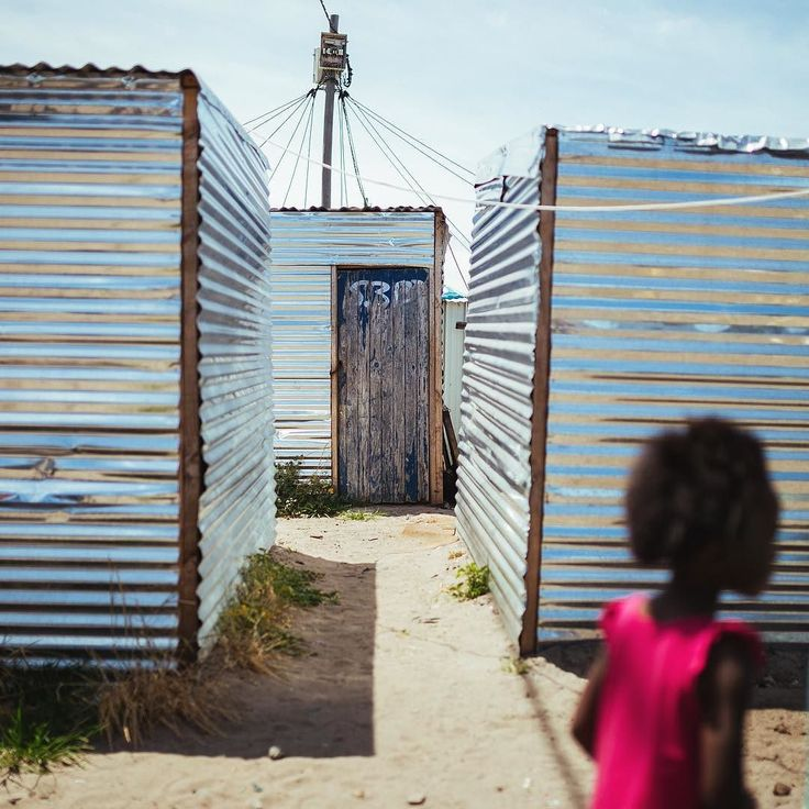 LANGA TOWNSHIP SOUTH AFRICA - Children play amoung the corrugated metal shacks…
