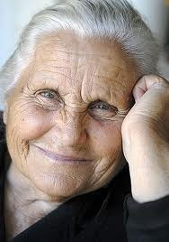 A Greek grandmother. She radiates happiness and makes me smile (mkc via Jana Lloyd).