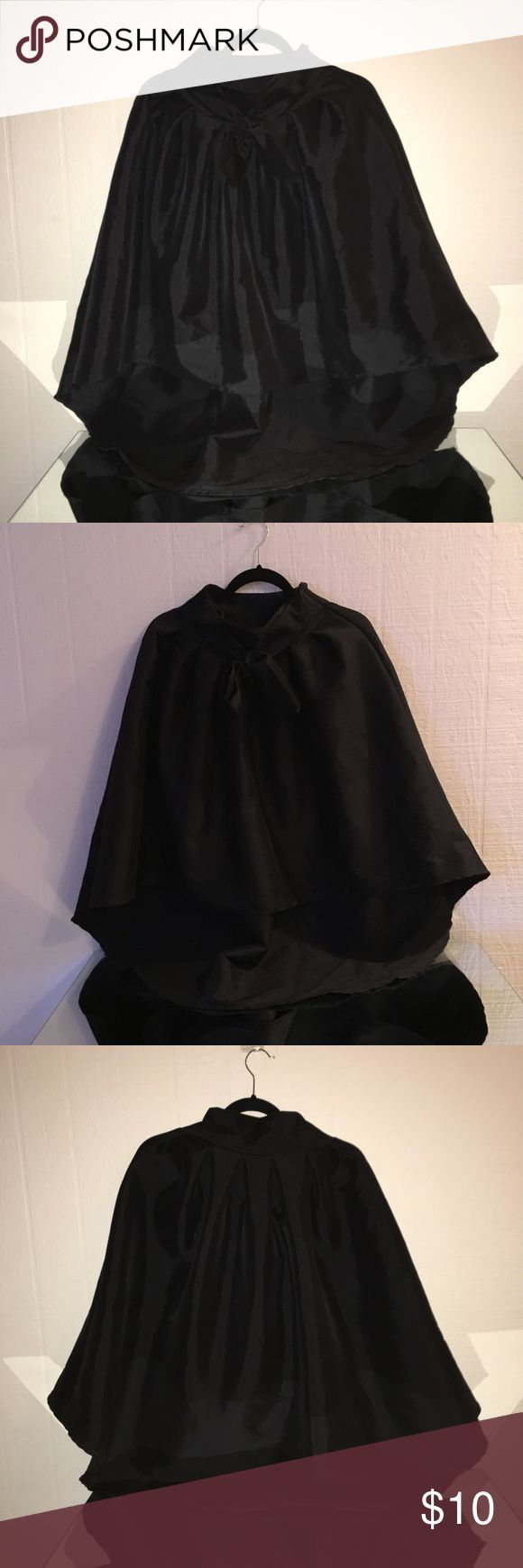 Black High Low skirt Made in USA High quality taffeta fabric Side zipper closure tie up belt pleated front midi length hi-lo skirt.                                                  This could be perfect for dance to even a Halloween Costume. Audrey Hepburn vibes. Worn once :) Skirts High Low
