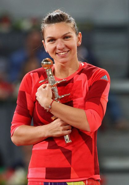 Simona Halep Photos - Simona Halep of Romania celebrates with the winners trophy after her win over Dominika Cibulkova of Slovakia in the final during day eight of the Mutua Madrid Open tennis tournament at the Caja Magica on May 07, 2016 in Madrid, Spain. - Mutua Madrid Open - Day Eight