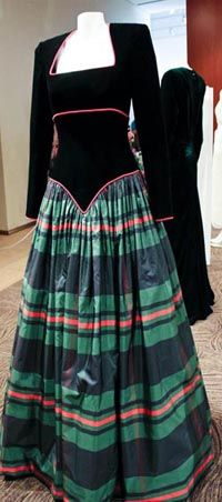 Designed by Catherine Walker. Black velvet bodice piped in red with a full skirt of green, black and red silk in a plaid design. Diana wore this gown to an evening of Scottish Dancing at Balmoral and to the National Gallery in Scotland in 1990. $46,000.00 Purchased by a woman from Florida
