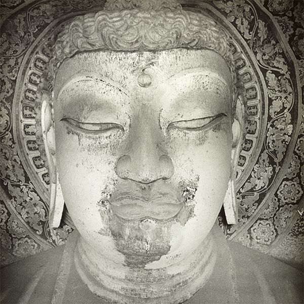 Photograph of head of Maitreya buddha in Dunhuang Mogao cave 130 taken by Desmond Parsons in 1935. Photo 1275/1(55).