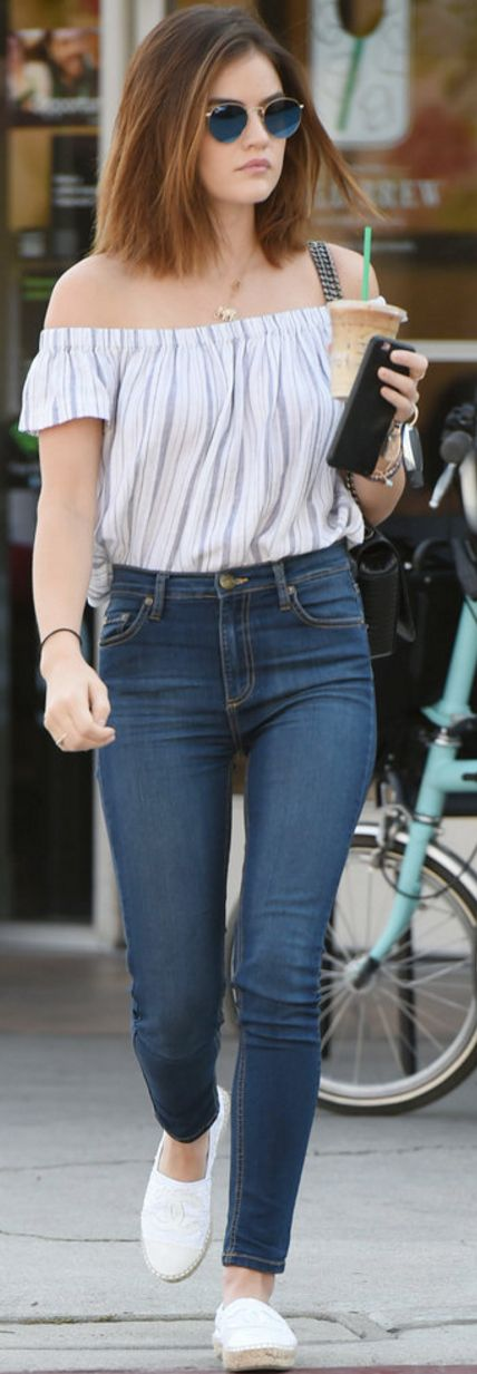 Who made Lucy Hale's white off the shoulder stripe top, blue skinny jeans, white shoes, black handbag, and round sunglasses?