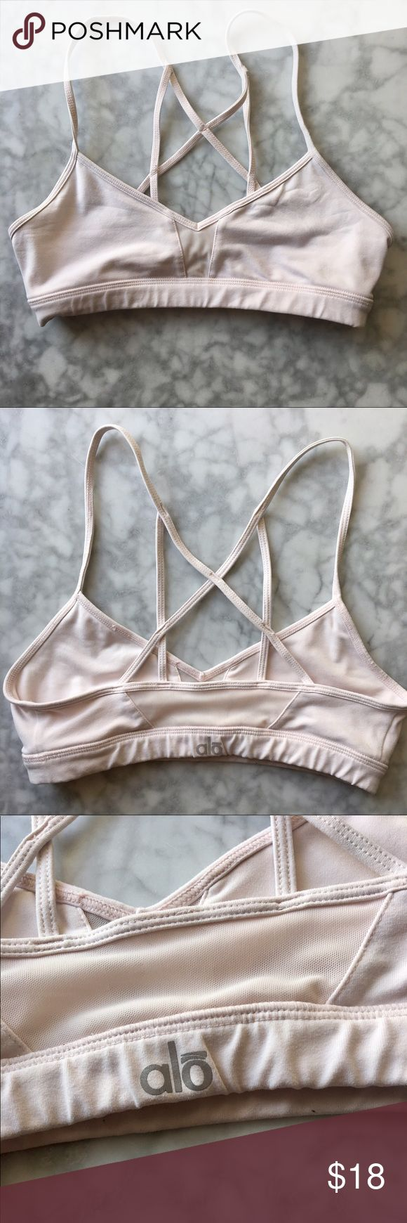 ALŌ Yoga Bra ALO Yoga Goddess Bra in a beautiful light pink 💕   This bra has been very loved but is still in good condition! It has some very light pilling on the inside of the bra (pictured), however the outside is perfect. Features a strappy back and mesh detail on the front and back.  This looks great under a dark colored tank and is perfect to practice yoga in. This was one of my favorite bras.  Retails for $54. Size XS.                  Also available on my de.pop for less with cheaper…